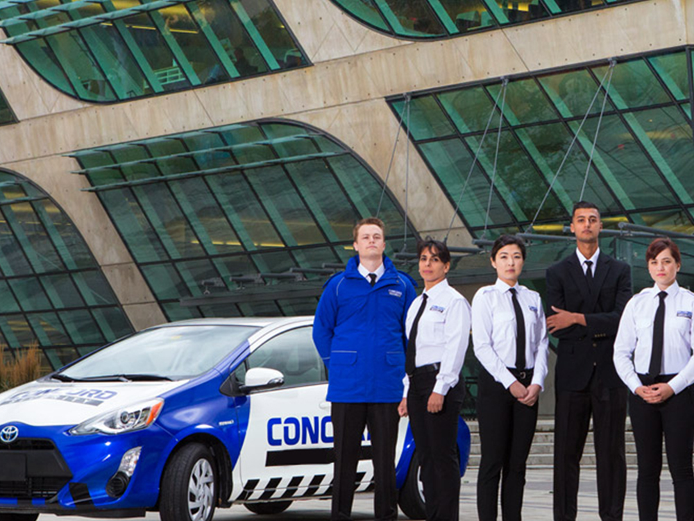 Five Concord employees standing together infront of a work vehicle
